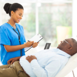 caregiver checking health to old man