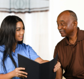 caregiver consulting old man